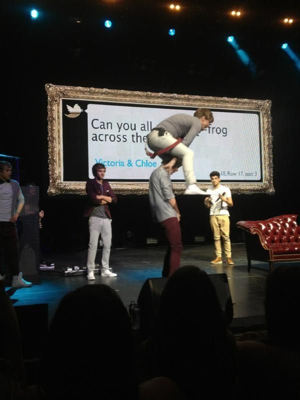 Louis tomlinson from One Direction jumping over liams head